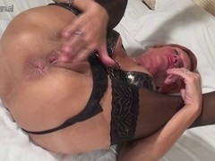 Squirting red mother toying her fur pie with banana