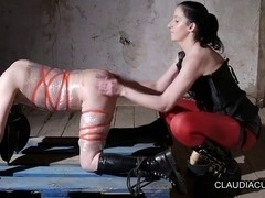 Dominatrix slut serves her slave with a BDSM fun