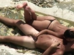 Woman initiates beach sex