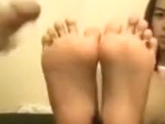 Cute small Oriental lets me cum on her feet