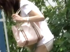 Skinny Japanese girl in a wild street sharking video