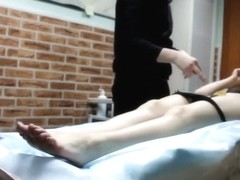 Professional master removes hair from girl's genitals