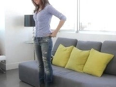 Teen brunette Emily plays with her cunt on a couch