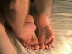 Man cums on two very sexy feet