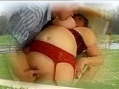 Fat mature babe gets fucked by two men.
