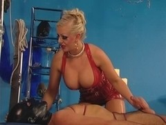Hot blonde in kinky latex catsuit does perfect handjob
