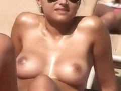 Hot girl with nice tits topless in the beach