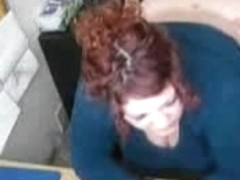 Chubby half-dressed redhead drilled by her boss