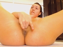 On the floor fingering her pussy