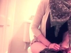 Woman caught in toilet taking a pee