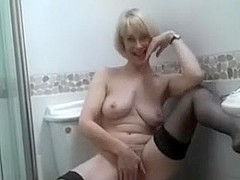My playful light-haired wife getting nasty in a bathroom