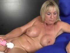 Bigtitted milf tugging gimps throbbing cock