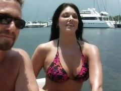Hot ass milf reveals her tits on the boat