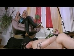 Footrest for Sexy Headmistress in Boots