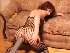 huge redhead in fishnet masturbates with dildo