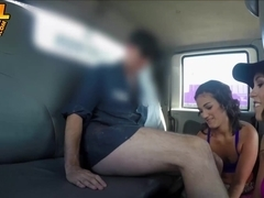 Two horny brunette hotties sucking one cock in the tow truck