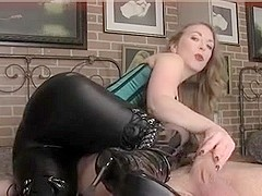 MISTRESS TEASES WITH HER BOOTS AS SHE JERKS COCK