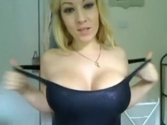 Squeezing her tits and oiling them up