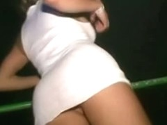 Bare pussy revealed at a party in this upskirt video