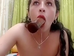 Lady puts in her mouth a sex toy