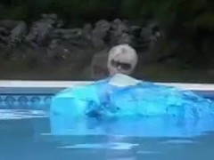 Blue whale inflating in swimming pool