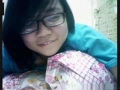 Nerdy asian girl has cybersex with her bf on skype
