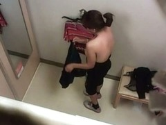 Hidden changing room camera captures busty chick trying on clothes