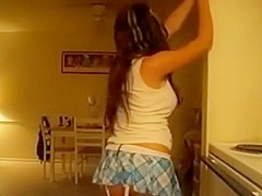 Sexy girl dancing in the kitchen