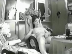 Voyeur tapes a brunette girl playing with her shaved pussy on a chair