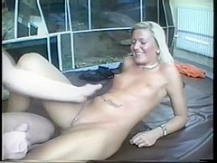 Oiled tattooed chick in amature porn