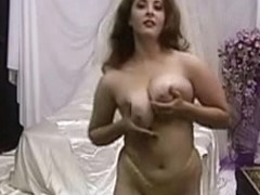 Hot Milf Jonee stripping showing her huge tits and hairy pussy