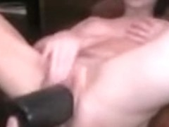 using a huge dildo and two hand fist