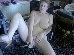 Mature woman is great at using dildo