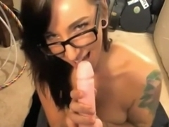 Cam girl is proudly showing off her body and sucking fake cock