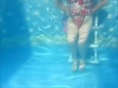 Underwater vid showing a peek of pussy & tits