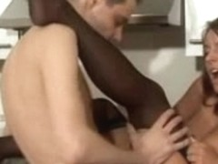 Sexy maid gives footjob in dark stockings