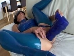female in blue latex rides large blue marital-device