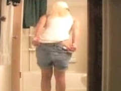 Naked bottom mature spied bent over as washing head