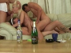 Blonde bombshell in group party sex video