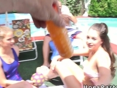 Foursome pool party with two teens