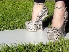 Heel less snakeskin 7 inch high shoes