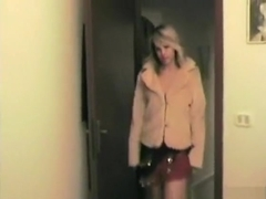 Blonde girl comes home from work and relaxes with a blowjob