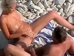 Mature couple on the nudist beach was spied and filmed by me