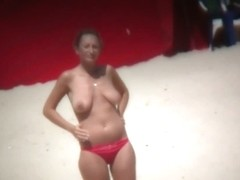 Big breasted woman meeting a hunk on the nude beach