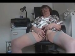 Nasty granny masturbates and poses seductively