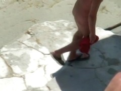 Blonde gets fucked on a beach