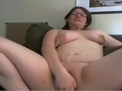 Mature chick puts pegs on her big tits.
