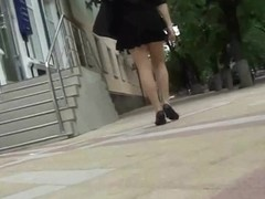 A hot bitch in seductive stockings has no idea about the voyeur