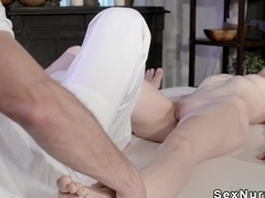 Brunette gets foot and pussy massaged