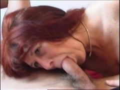 Redhead Mom in stockings blowing cock and fucking
